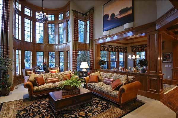 Formal living room with a 2-story ceiling, and bayed windows.