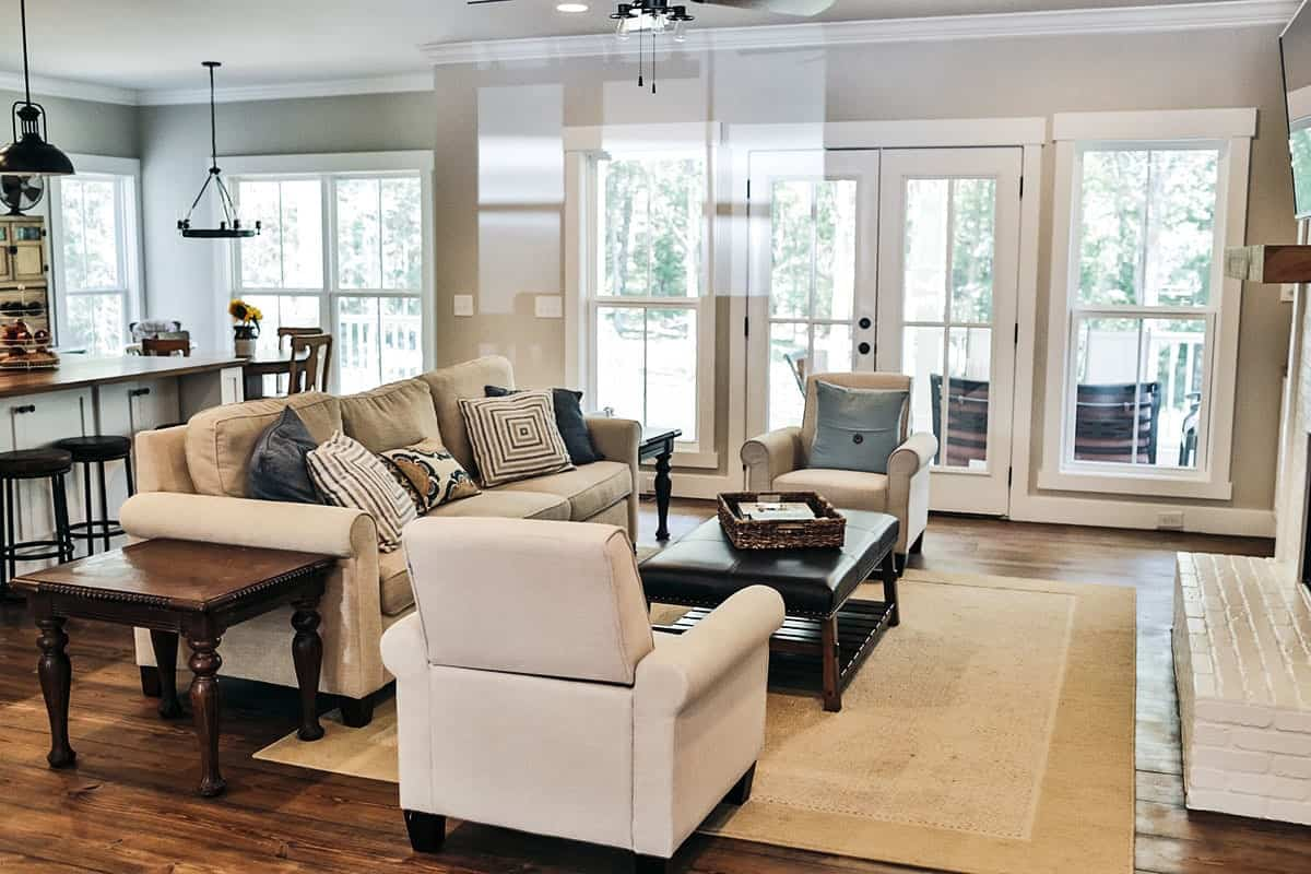 Living room with natural hardwood flooring and a french door leading out to the grilling porch.