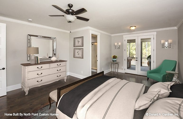 This bedroom has a private bath and french doors leading out to the screened porch.