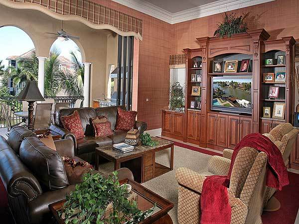 Family room with cozy seats and sliding glass doors that open out to the covered balcony.