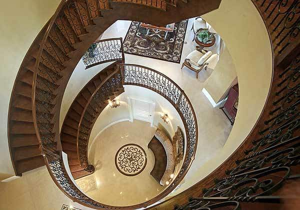 Top view of the magnificent stair rotunda boasting a curved seat under the framed artwork