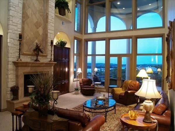 The family room has a warm fireplace and full-height windows that allow an abundance of natural light in.