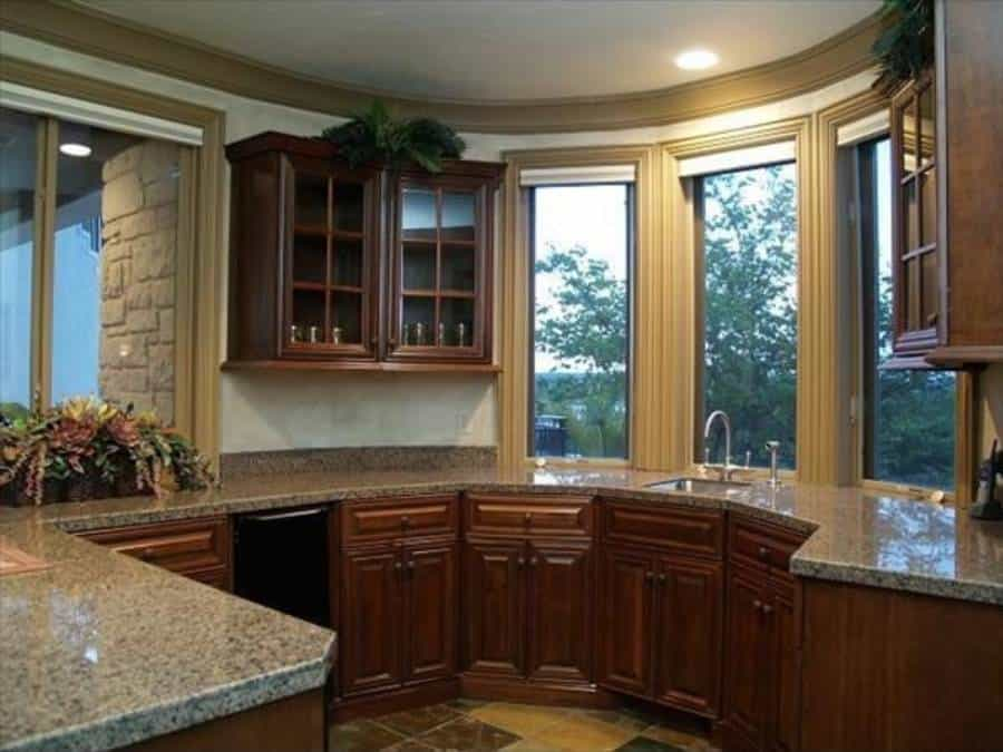 Kitchen with wooden cabinetry and granite countertops fitted with an undermount sink.
