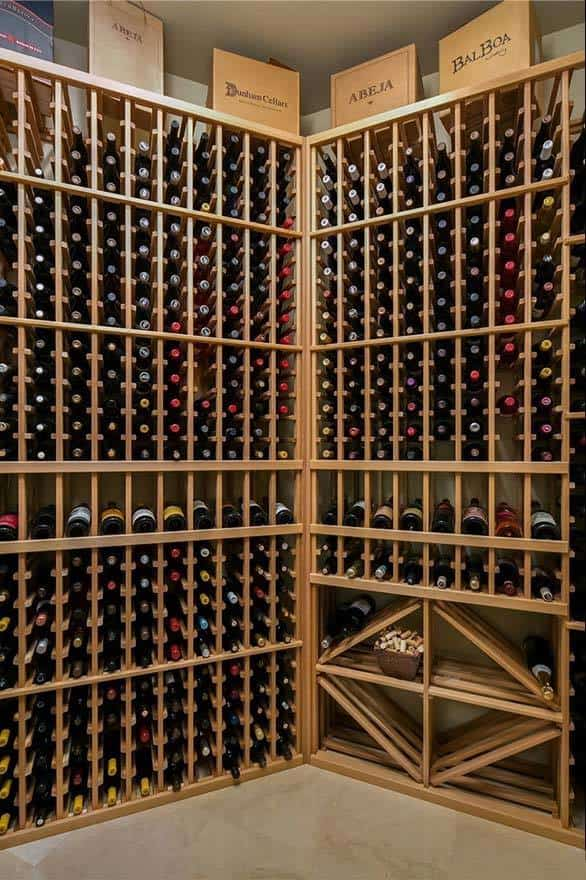 The wine cellar filled with diamond and column shelves.