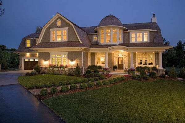 Night view of the home facade shows the glowing ambient lighting that complements the house.