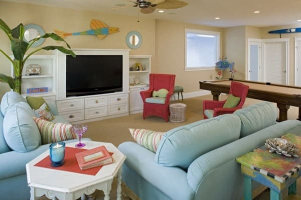 Recreation room with multi-colored seats and a TV mounted on the built-in cabinet.