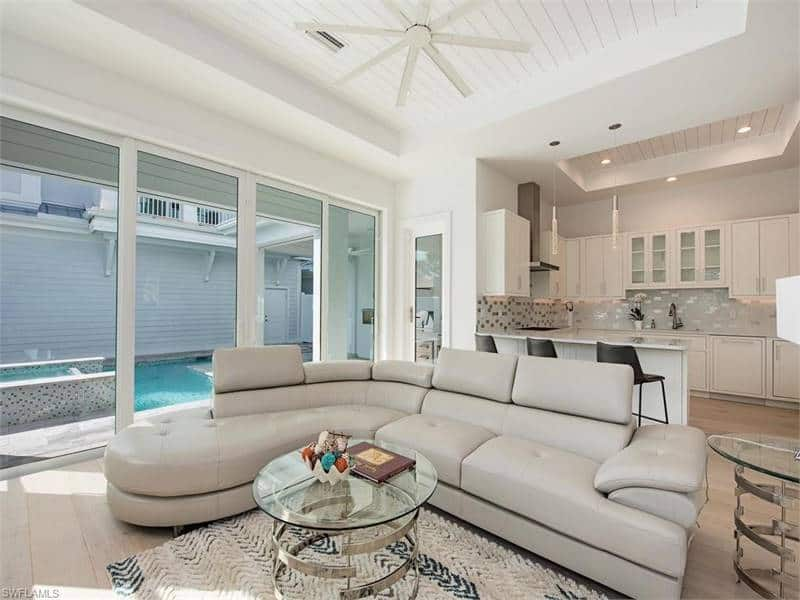 Across the kitchen is the great room with sliding glass doors that open to the lanai and pool.