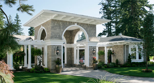 The main gate is surrounded by open archways and clad in bricks with mounted sconces.