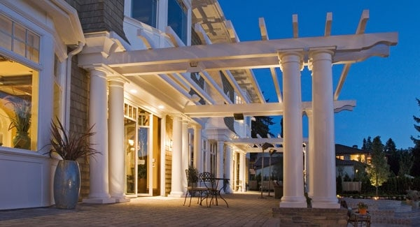 The rear terrace is framed with decorative columns that add curb appeal to the house.