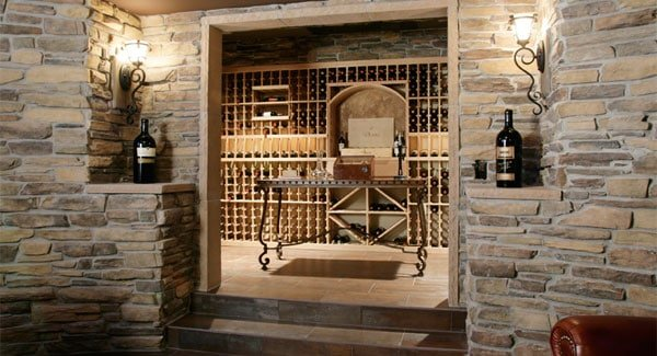 The wine cellar has column shelves and an ornate counter matching with the glass sconces on the entrance.