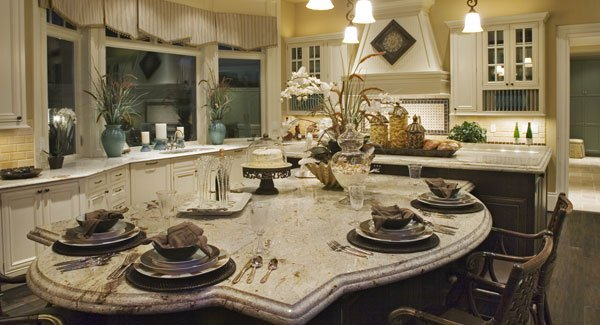 A closer look shows the marble top island attached with an eating counter for casual dining.