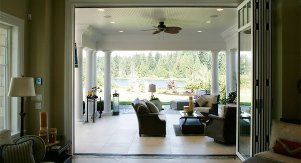 The outdoor living with multiple seats. accessible via the sliding glass doors.