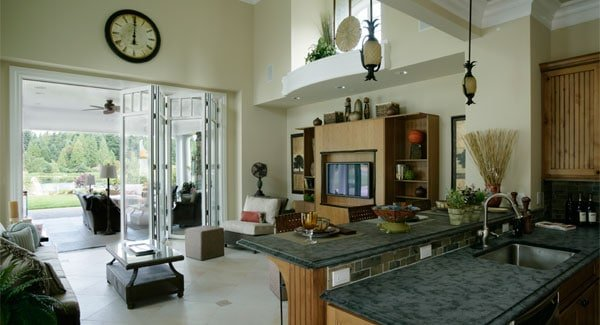 Living room with a high ceiling, marble tiled flooring and a bar on the side.