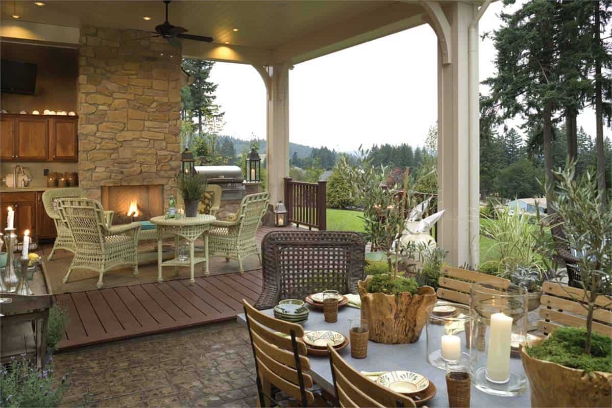There's also a fireplace and an outdoor kitchen complete with a grilling station.