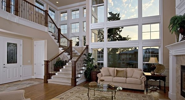 Home's foyer with a white double door opens to the living room and staircase leading to the bedrooms.