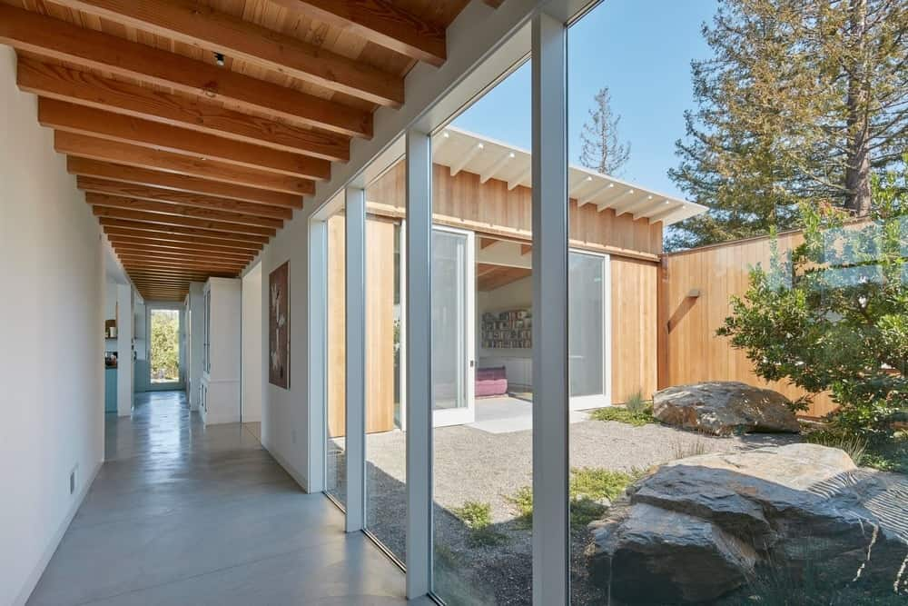 Hallway and patio in the Modern-Day California Ranch House designed by Malcolm Davis Architecture.