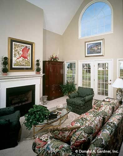 The great room with a cathedral ceiling, clerestory window, and fireplace.