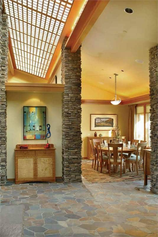 Behind the foyer is the formal dining room with a vaulted ceiling.