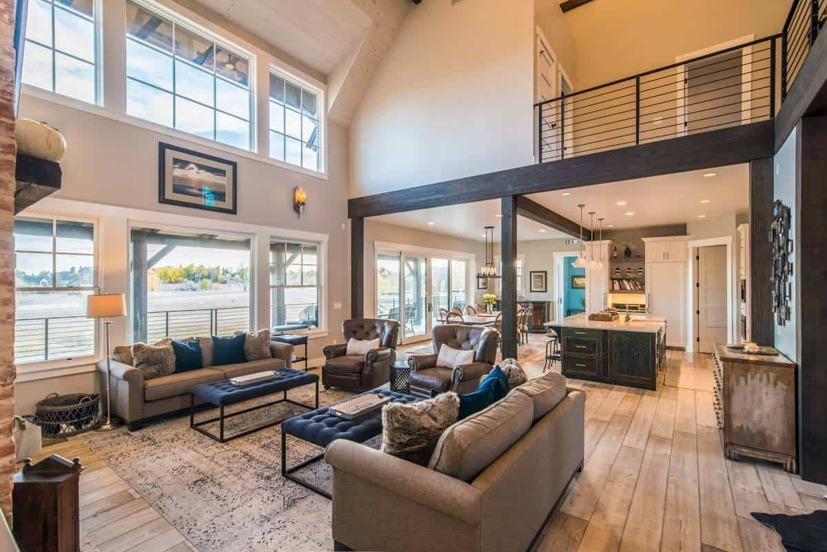 Open floor layout with the view of the kitchen, dining and the living room with a soaring vaulted ceiling.