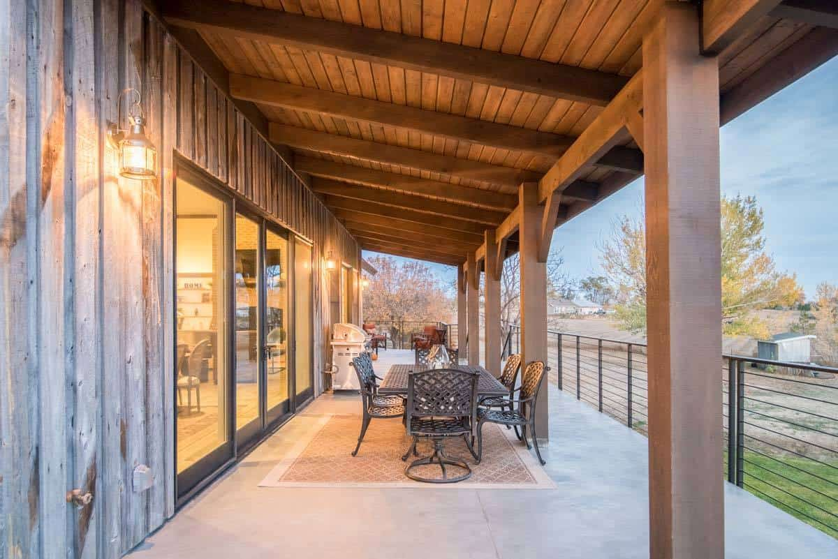 The sliding glass doors from the dining lead to the covered rear porch with perforated dining set.