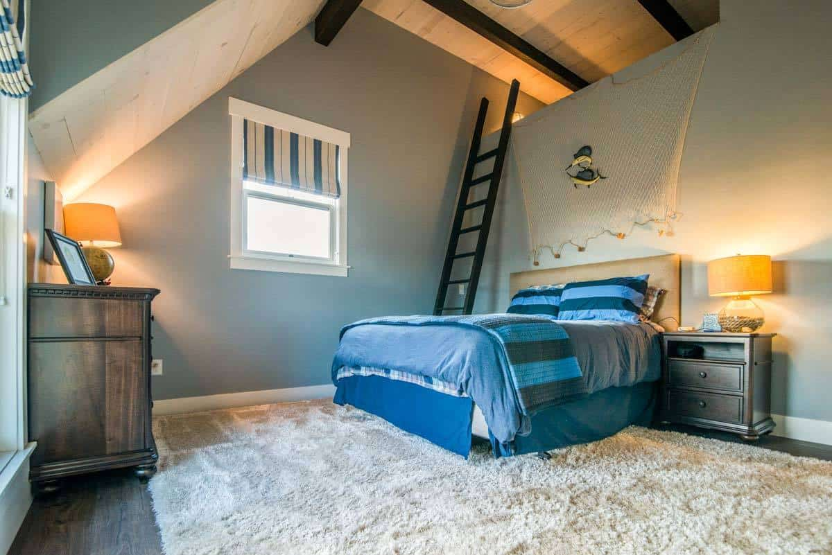 Bedroom with a ladder and a beige upholstered bed over a shaggy area rug.