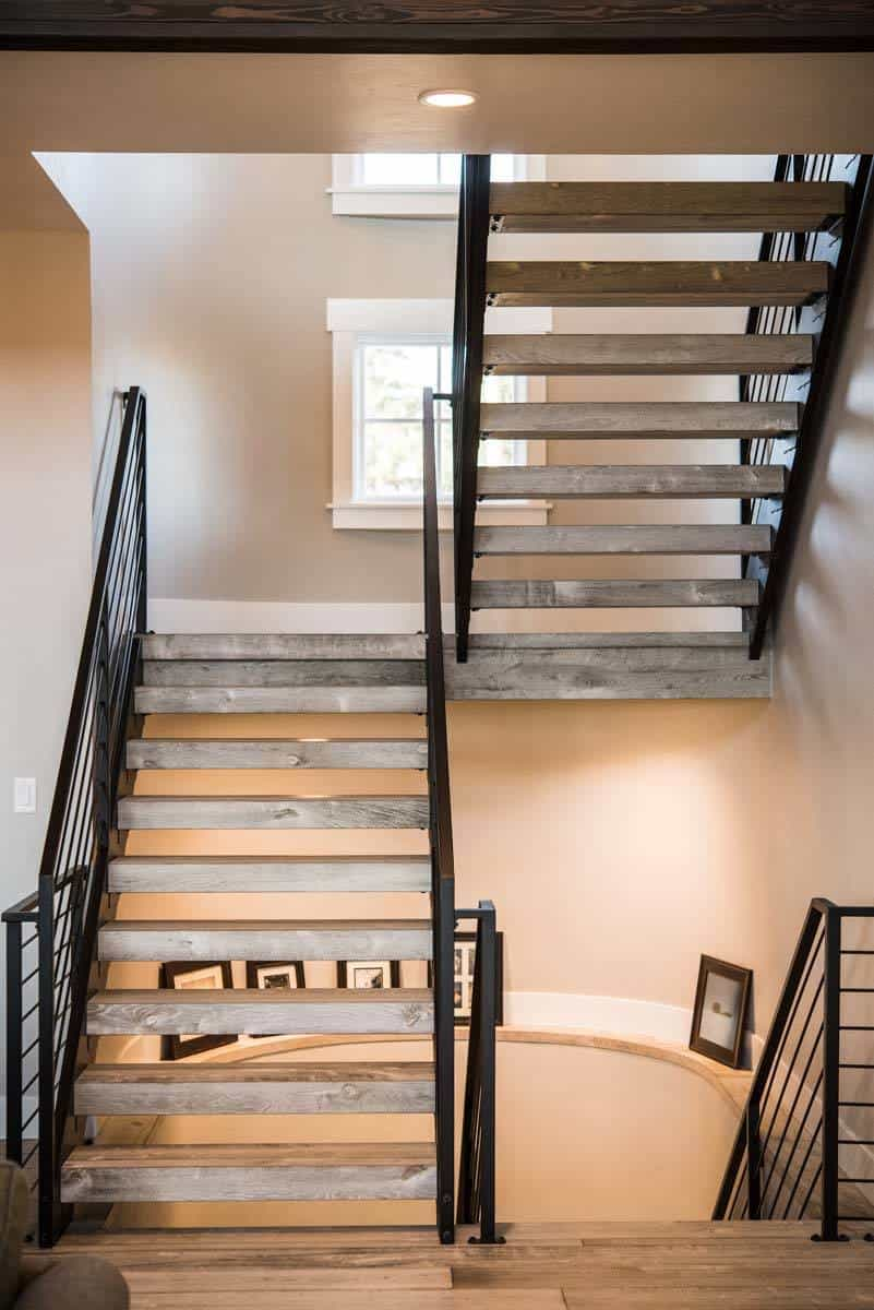 Wooden staircase leading to the lower level.