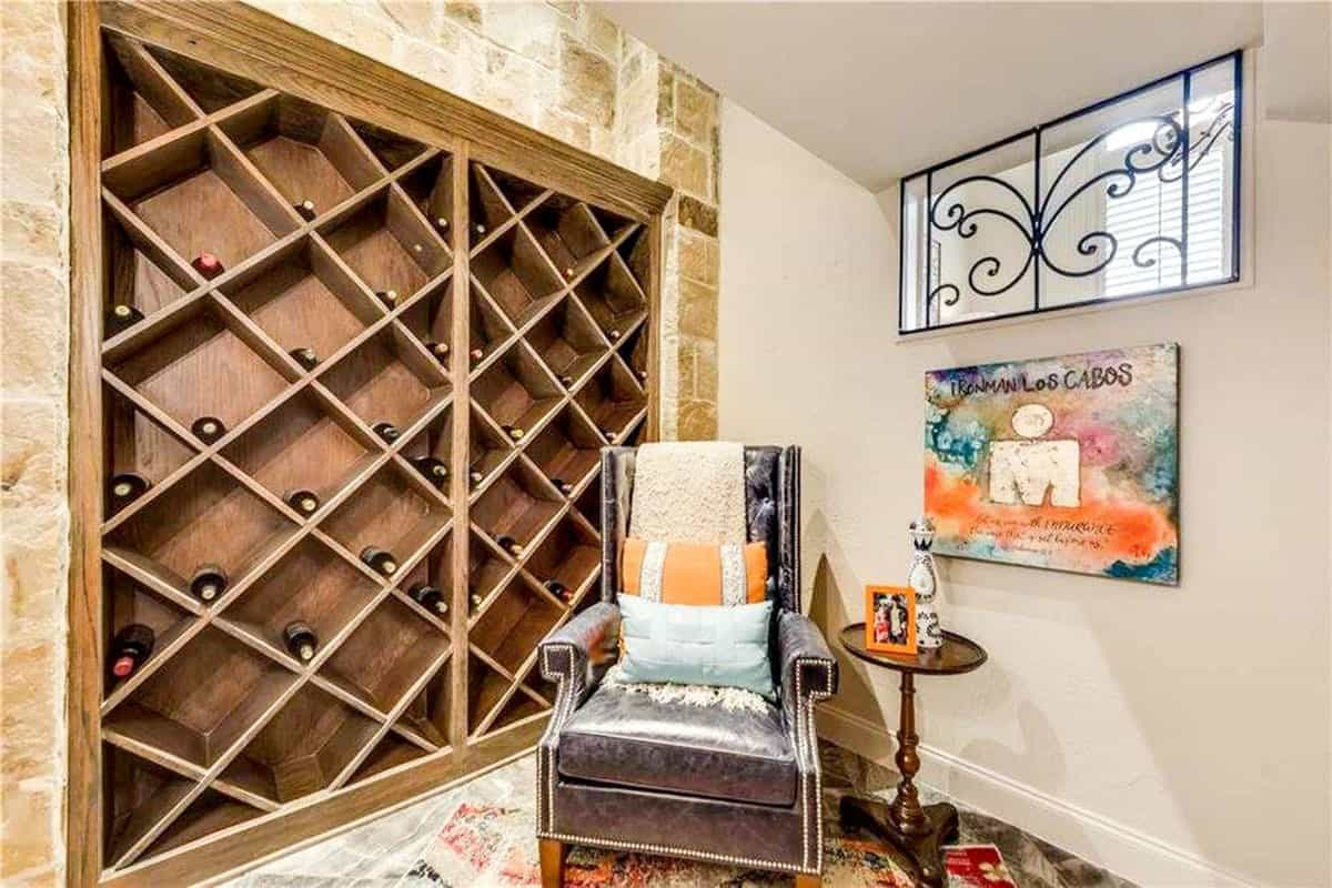Wine storage with crisscross shelves complemented with a leather tufted chair and a round side table.