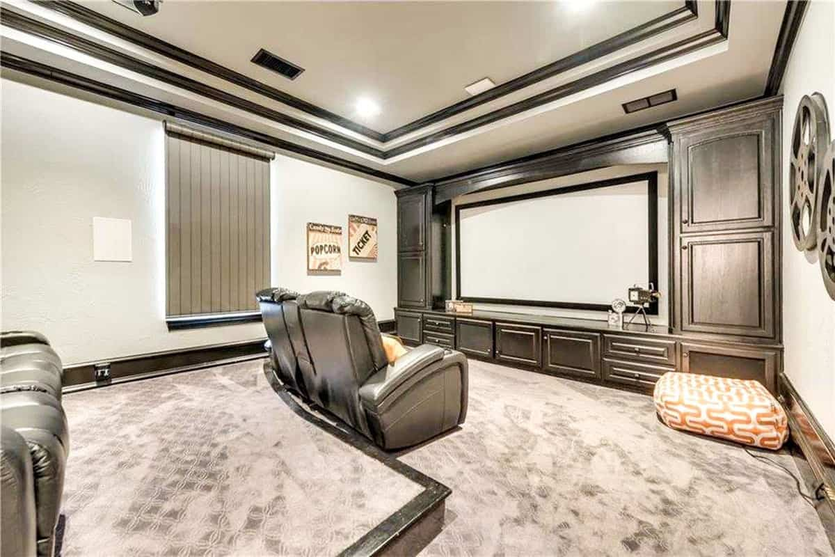 This view shows the large projector screen surrounded by built-in cabinets.