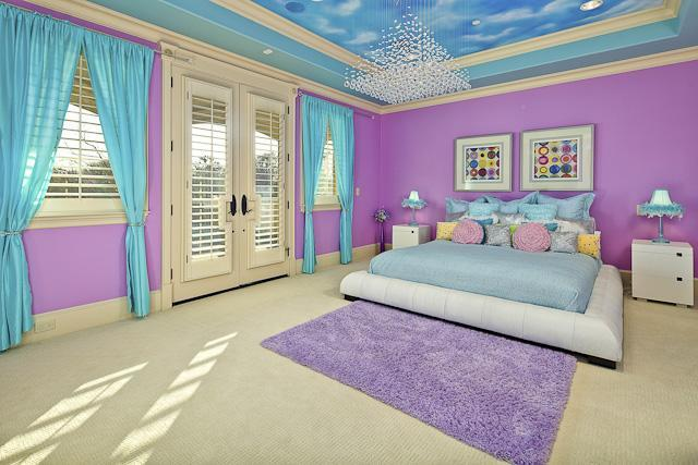 Kid's bedroom with vibrant purple walls and a stunning sky ceiling mounted with a cascading chandelier.