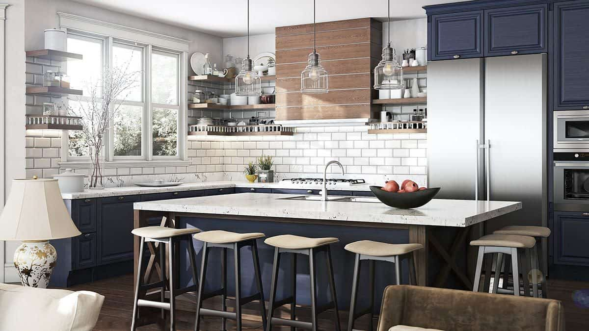 The kitchen has dark blue cabinetry and a marble top island complemented with cushioned bar stools.