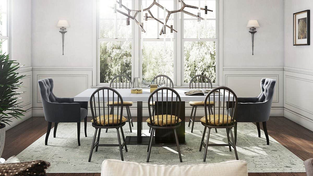 The dining room with a patterned rug and a modern dining set illuminated with a contemporary chandelier.