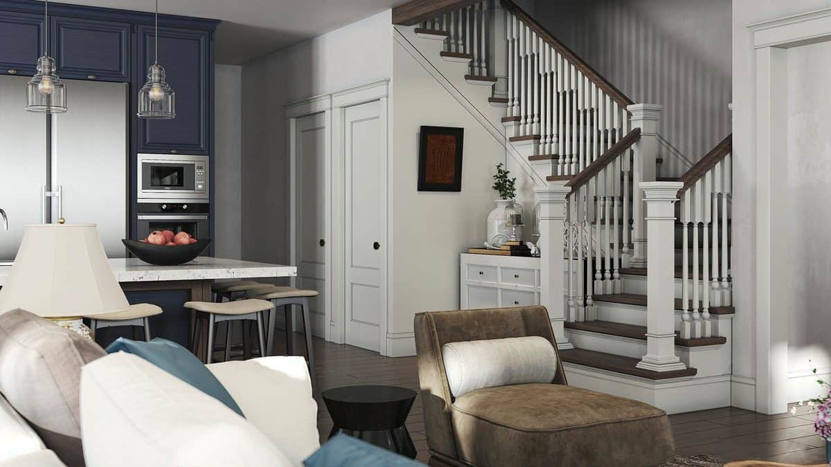 Traditional staircase in the living space leading to the bedrooms.