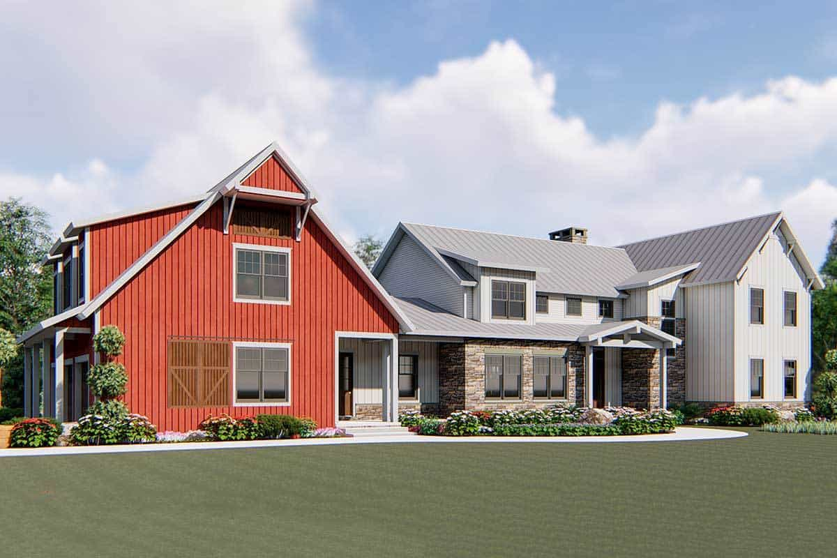 Home's facade showing the red barn-style garage and white exterior siding accentuated with stunning stone bricks.