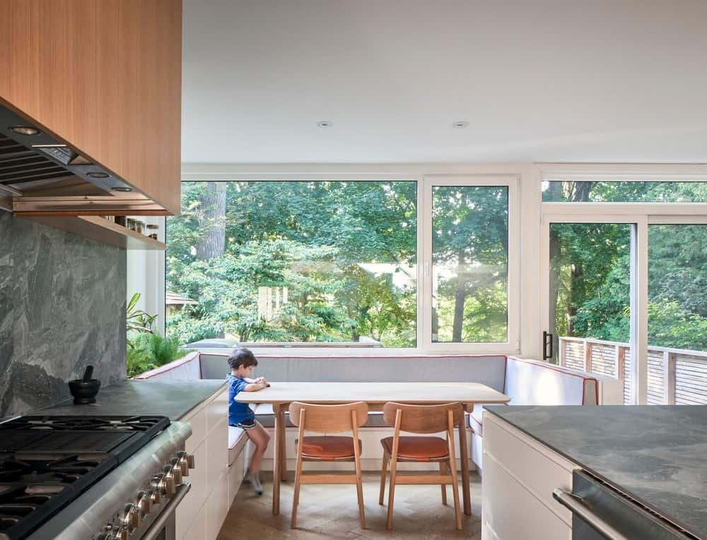 Shared dining area and kitchen in the Baby Point Residence by designed Batay-Csorba Architects.