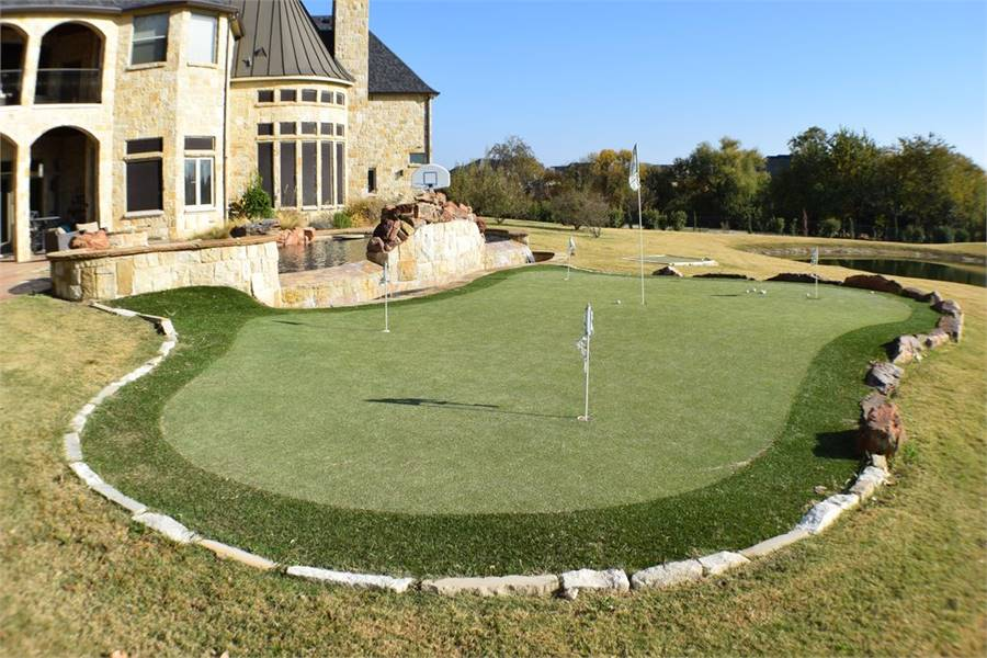 A mini-golf course is situated next to the swimming pool.