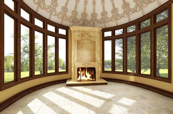 Morning room with a marvelous dome ceiling and a warm fireplace situated in the middle of the glass-paneled windows.