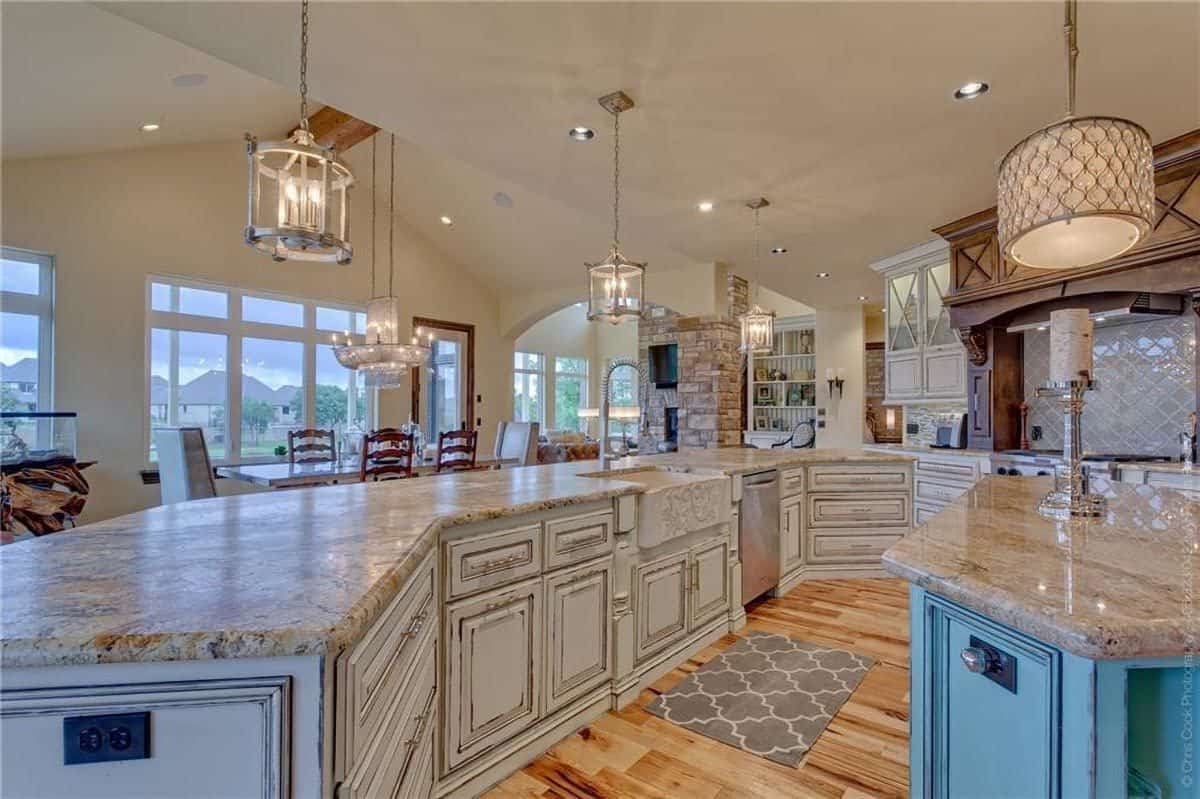 The kitchen has a drop ceiling and a granite top peninsula facing the dining area across.