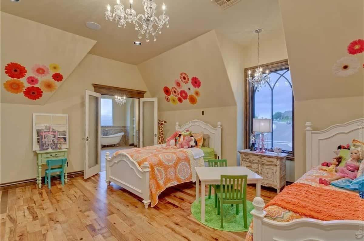 The opposite side view shows the vaulted walls adorned by floral murals and a french door leading to the bathroom.