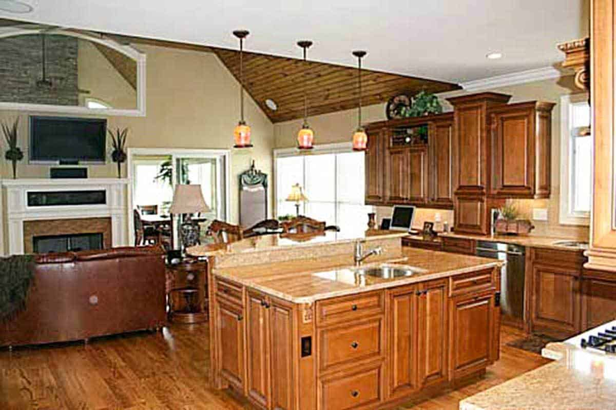 The kitchen across the family room features a two-tier breakfast bar fitted with a sink.