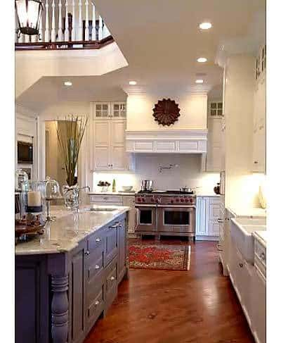 The gorgeous kitchen with farmhouse sink and a central kitchen island.
