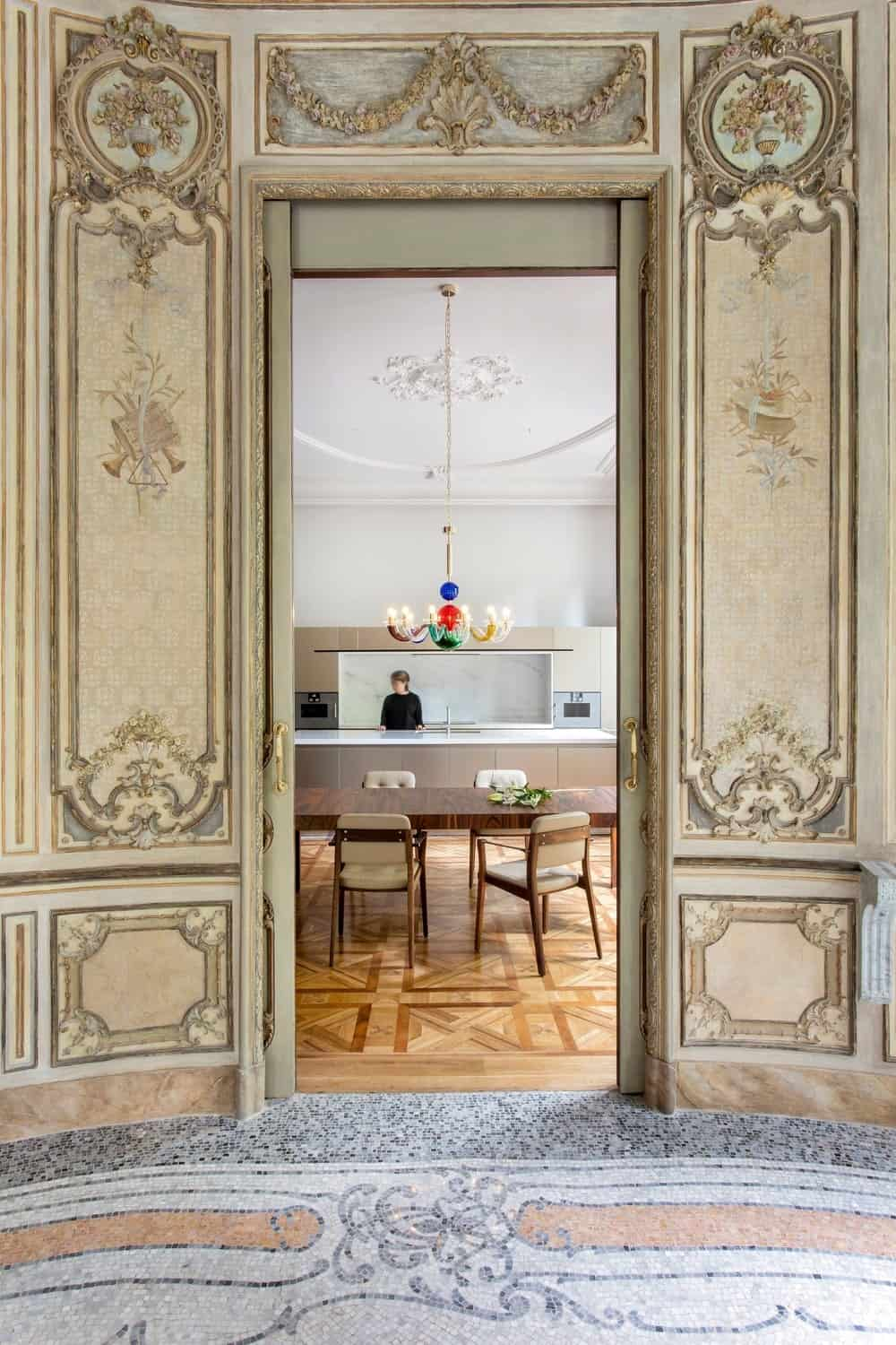 View of the dine-in kitchen from the rotunda foyer in the Casa Burés designed by Estudio VILABLANCH + TDB Arquitectura.