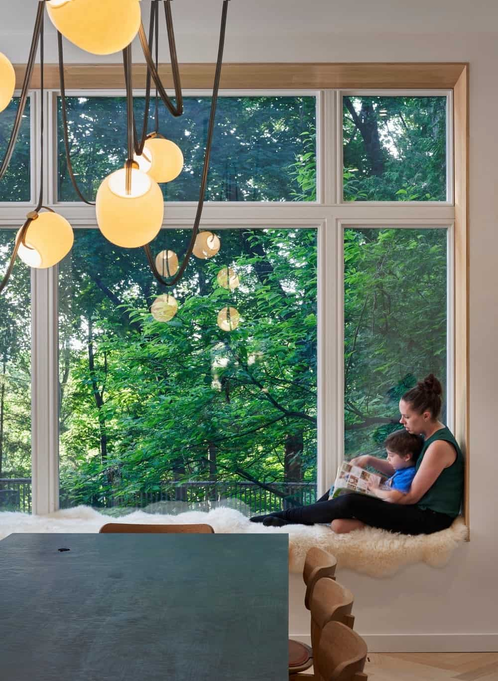 Dining room with window seat in the Baby Point Residence by designed Batay-Csorba Architects.