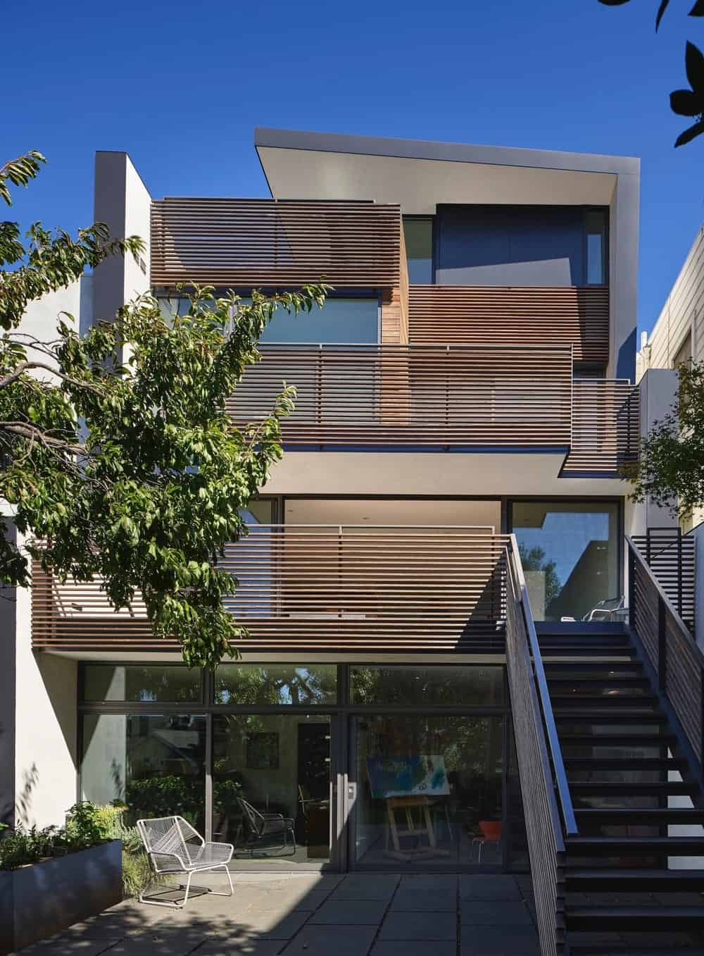 Rear exterior view of the House on Hillside designed by Terry & Terry Architecture.