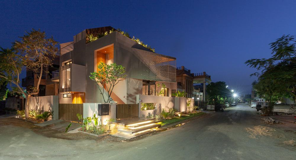 Angled side exterior view during night of the Chhavi House (Oasis in the Thar Desert) designed by Abraham John Architects.