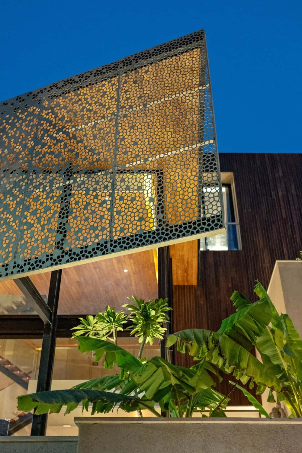 Decorative perforated screen adorning the Chhavi House during night (Oasis in the Thar Desert) designed by Abraham John Architects.