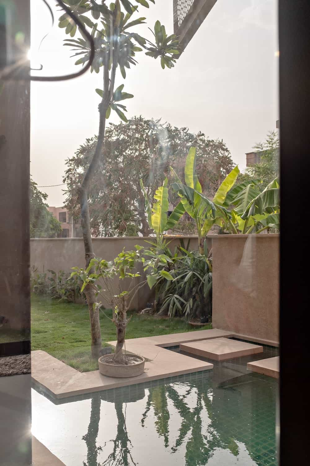 Swimming pool in the Chhavi House during night (Oasis in the Thar Desert) designed by Abraham John Architects.