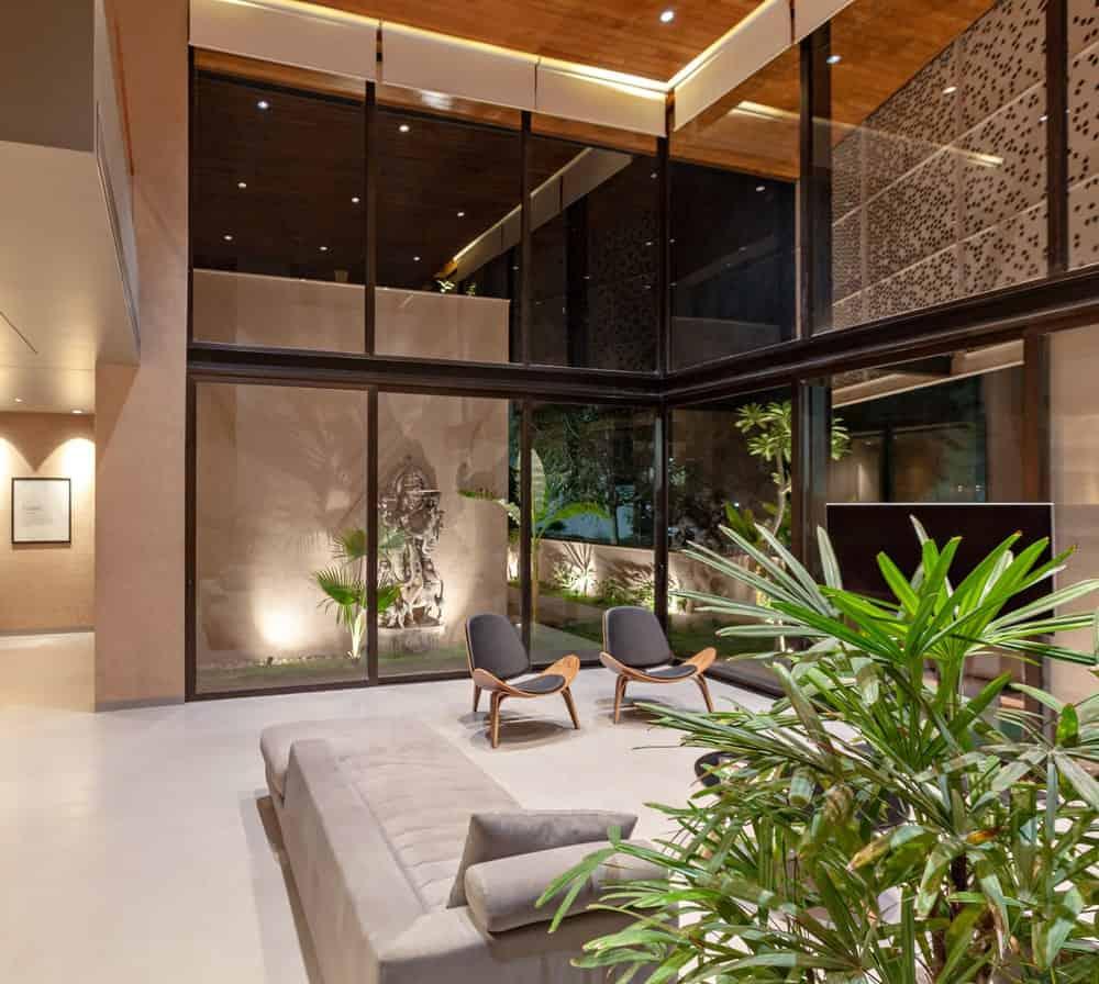 Living room in the Chhavi House during night (Oasis in the Thar Desert) designed by Abraham John Architects.