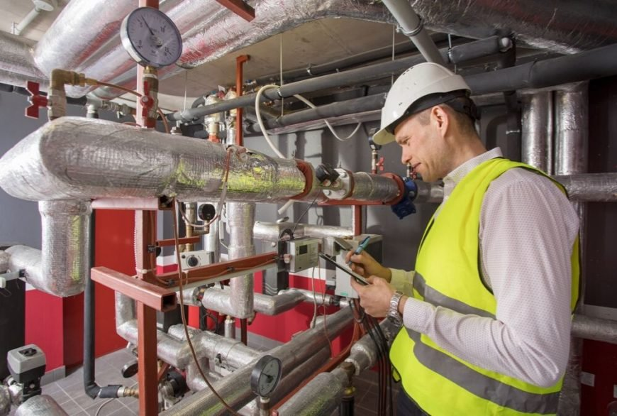 Commercial HVAC professional working on HVAC system