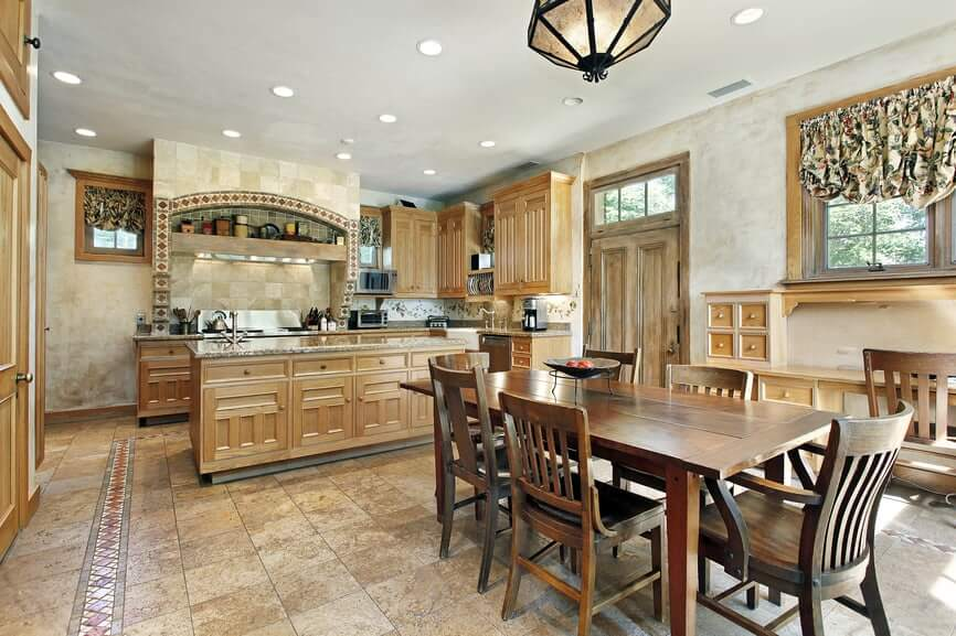 The fascinating plan idea here is the way the tile floor coordinates the cabinetry making a bound together shading plan