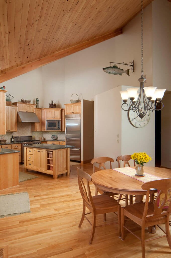 The white walls and correspondingly hued wood all through this room allow the stainless steel appliances and complement ledges to truly pop.